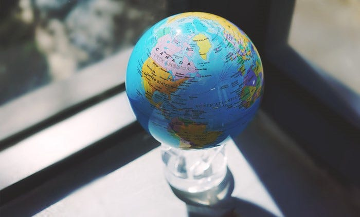 "Pictured: 4.5"" Blue with Political Map MOVA Globe"