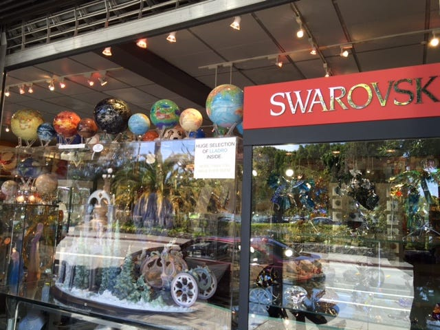 MOVA Globes displayed beautifully in Burlwood's storefront window.