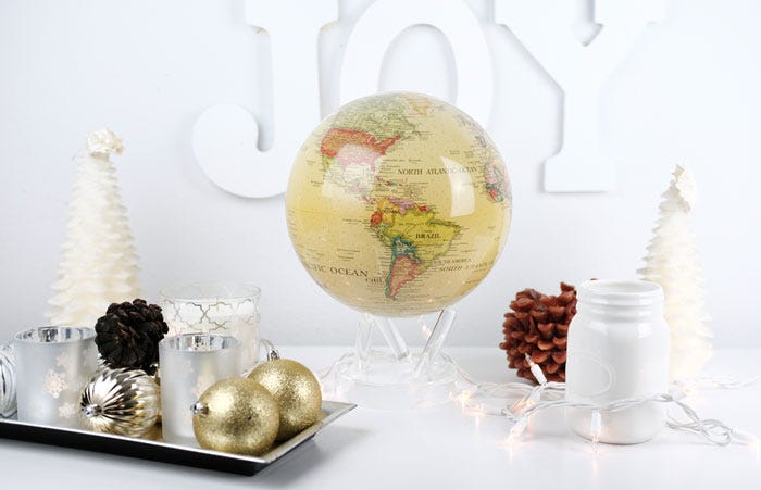 Yellow political MOVA globe with christmas decor