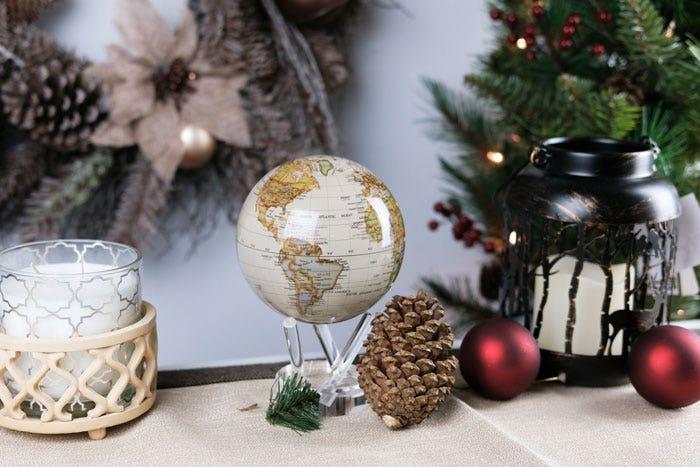 Antique gloss finish MOVA globe with christmas decor