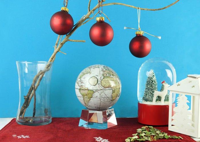Antique terrestrial MOVA globe with christmas decor