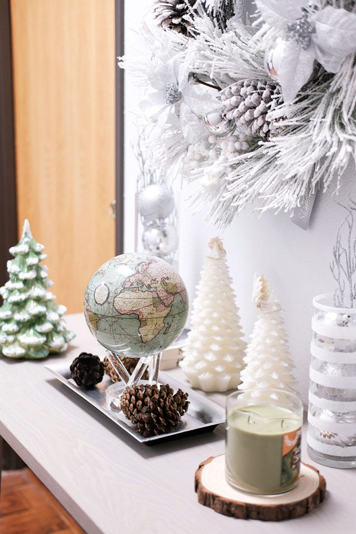 Antique terrestrial green MOVA globe with holiday decor