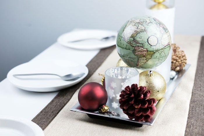 Green cassini globe with holiday decor