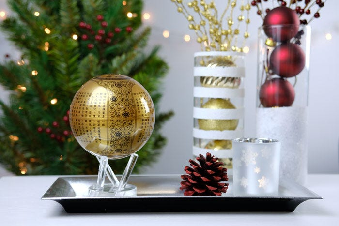 Gold sutra heart MOVA globe with christmas decor