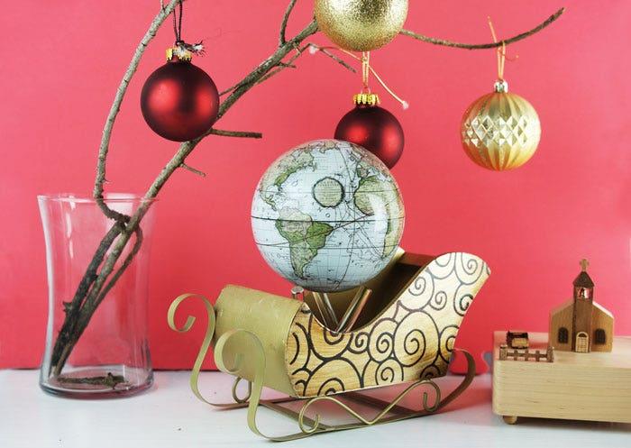 Antique terrestrial white MOVA globe with christmas decor