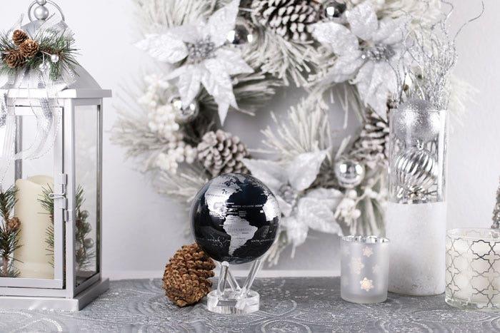 Black and silver MOVA globe with holiday decor
