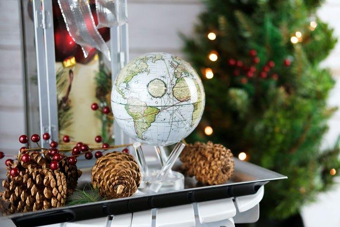 White cassini globe with holiday decor