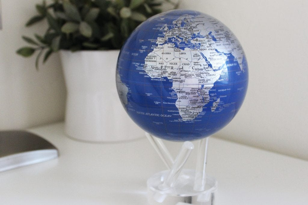 Blue and Silver MOVA Globe on our 3 prong acrylic stand