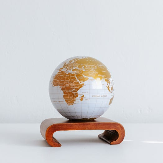 "White and Gold MOVA Globe 4.5"" with Arched Base Dark Wood"